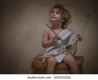 A beautiful child with blonde curly hair and a bow and arrow as cupid, appearing as an oil painting as a Valentine's Day. The God of Love, represented in a photo appearing as an oil painting.