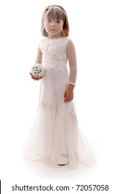 Beautiful child with bride clothes holding a bouquet .