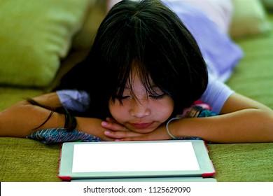 beautiful Child, Cheeks in Hands enjoy looking ipad