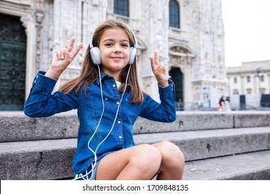 Beautiful child enjoy her holiday in front of Duomo Milan