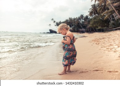 Beautiful child girl walking on beach during summer holidays concept carefree childhood travel lifestyle