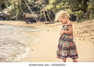 Beautiful child girl walking on beach tropical island during summer holidays concept carefree childhood travel lifestyle