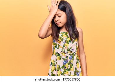 Beautiful child girl wearing casual clothes surprised with hand on head for mistake, remember error. forgot, bad memory concept.