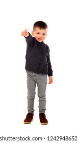 Beautiful child indicating something with his fingers isolated on a white background