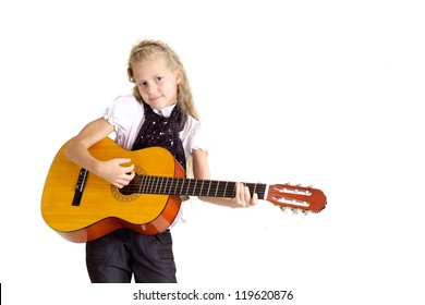 beautiful child with a musical instrument on white background