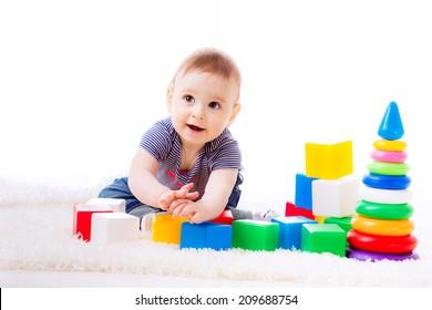 beautiful child plays cubes