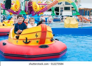 Beautiful children having fun at an amusement park.  Children on the ship.