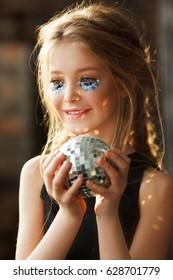 Beautiful children portrait. Gleam art professional make up. Day light.