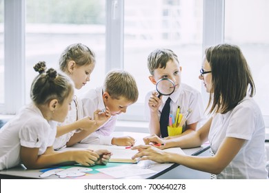 Beautiful children are students together in a classroom in school get the education with the teacher