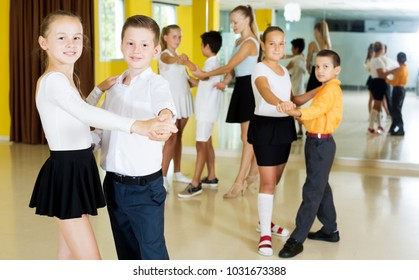 Beautiful children studying of partner dance  at dance school