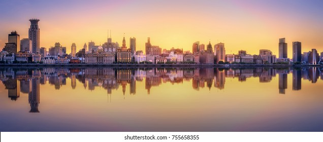 Beautiful chinese cityscape of Shanghai's skyline with the city lights and tower on the Huangpu River bay, Shanghai, China.
