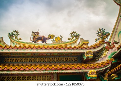 Beautiful Chinese dragon-headed unicorn statue on the temple roof. Kylin or Kirin on roof in Chinese temple.