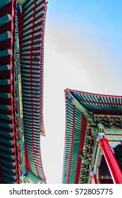 Beautiful Chinese temple roof detail with colorful architectural work at Wat Leng Nei Yi 2, Nonthaburi, Thailand.