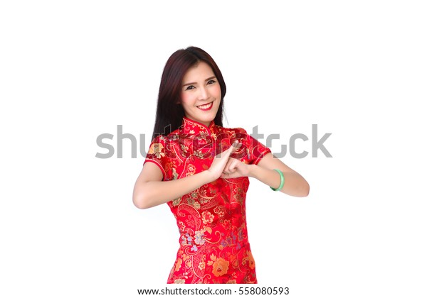 ad2556850 Beautiful chinese woman wear cheongsam and respect hand in chinese new year  on white isolate background