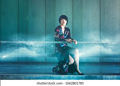 Beautiful Chinese young woman in urban tech background, Chinese space race concept - Chinese girl in steel background, she has a spatial reference with stars and the Milky way graph texture