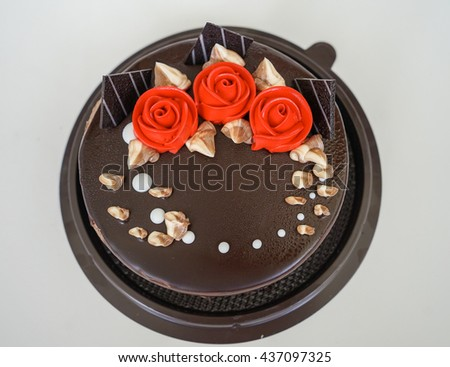 A Beautiful Chocolate Birthday Cake With Edible Red Rose Flowers