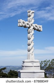 Beautiful christian cross carved in stone with interlaced effect located at the highest point of the Sintra hills (Cruz Alta)