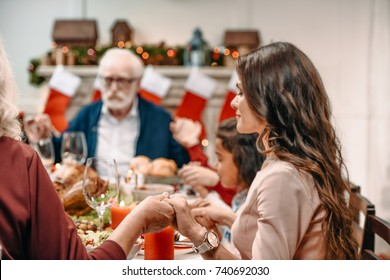 beautiful christian family praying before christmas dinner