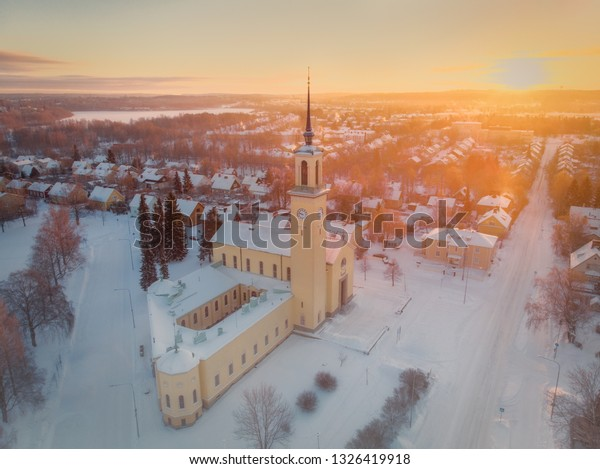 The beautiful christian Viinikka Church enjoys sunrise on a cold winter morning in Tampere, Finland