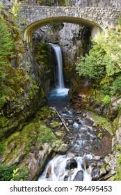 Beautiful Christine Falls under the bridge in Mount Rainier National Park, Washington state, USA long exposure to blur the water motion