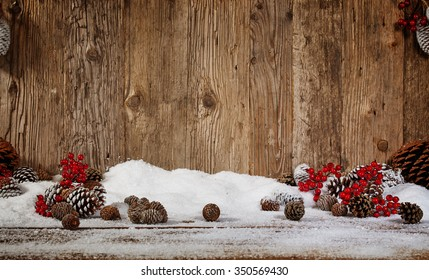 Beautiful Christmas background with the branches of the Christmas tree and snow on wooden background. View with copy space