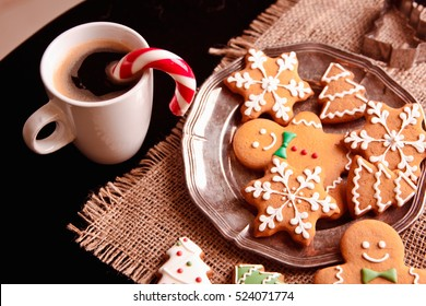 Beautiful Christmas background cookies and cap of coffee on dark background