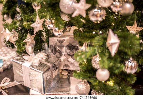 Beautiful christmas background. Decorated christmas tree with gift boxes