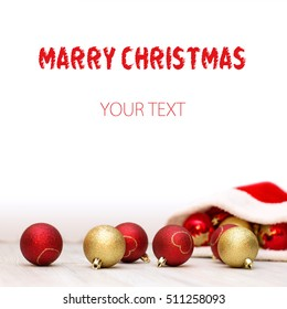 Beautiful christmas background with Santa Claus hat and red, gold balls for xmas design with space for text