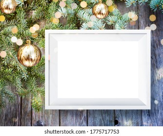 beautiful Christmas background with Christmas tree branches, boke lights, golden balls and wooden wall