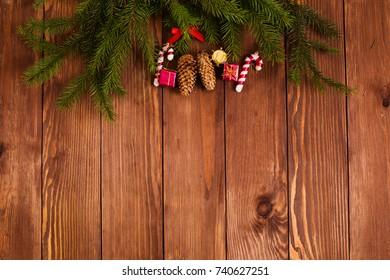 Beautiful christmas background. Christmas tree and Christmas toys on a wooden background