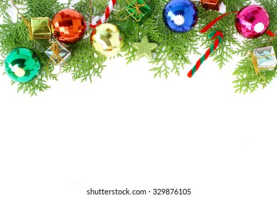 Beautiful Christmas ball decoration and pine leaves on white background