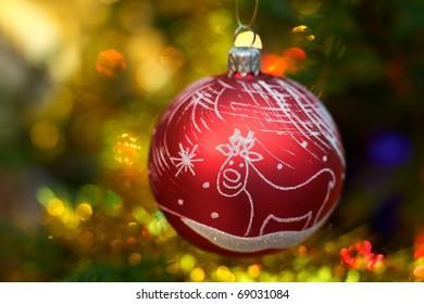 Beautiful Christmas ball on the tree - Defocused
