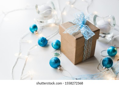 Beautiful Christmas composition with gift or present box in decoration against holiday lights background.