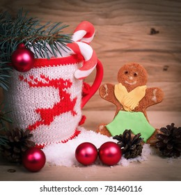 beautiful Christmas Cup and gingerbread man on wooden table