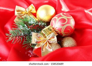 Beautiful Christmas decor on red satin cloth
