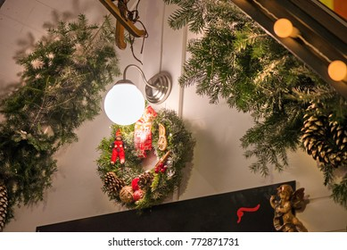 beautiful christmas decorations hanging on doors outside the house green needle crown with pine cones