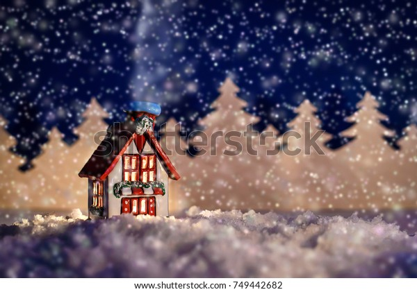 Beautiful Christmas fairy-tale picture of a winter cabin in a forest at night in the snow
