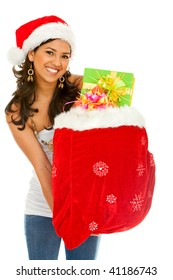 Beautiful christmas girl with a bag full of presents isolated on white