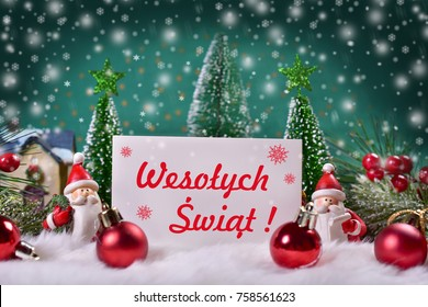 beautiful christmas greeting card with winter scene and red text Merry Christmas in polish language
