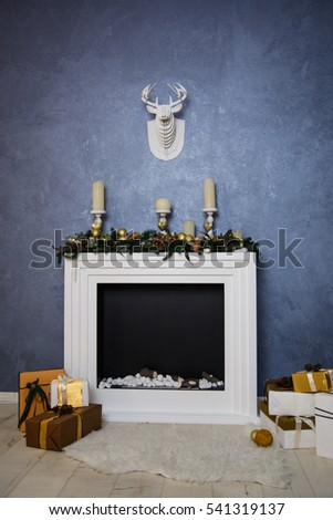 Beautiful Christmas interior with a fireplace candles and gifts. House. Comfort. Mock & Beautiful Christmas Interior Fireplace Candles Gifts Stock Photo ...