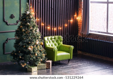 beautiful christmas interior with green leather chair loft wall with light bulbs and christmas tree