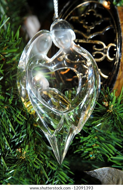 Beautiful Christmas ornament of Mary and Joseph and baby Jesus.  Crystal ornament with glowing light behind halo of child.