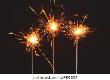 Beautiful Christmas sparklers on dark background