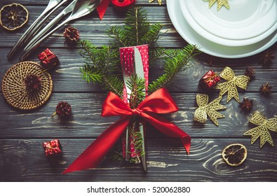 Beautiful Christmas table place setting. Idea for festive table ware decoration. Preparing for Christmas concept.