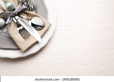 Beautiful Christmas table setting on white wooden background, top view. Space for text