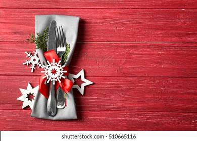 Beautiful Christmas table setting on red background