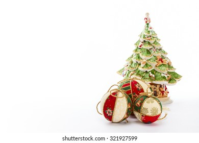 beautiful christmas tree and balls on white background