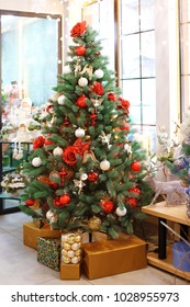 Beautiful Christmas tree decorated by professional florist in flower shop