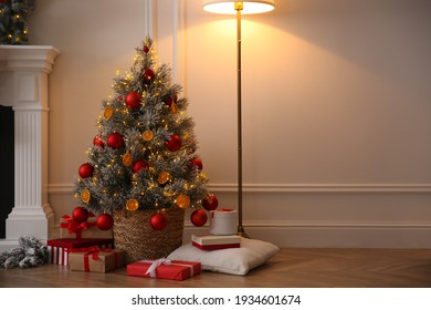 Beautiful Christmas tree and gift boxes in room. Space for text