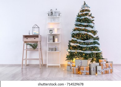 Beautiful Christmas tree with gift boxes in interior of living room